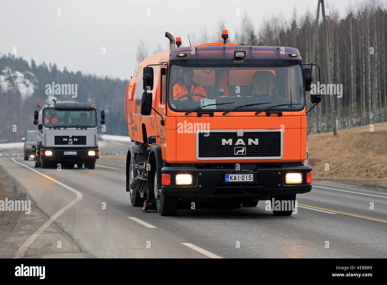 SALO, FINLAND - MARCH 24, 2016: Two MAN Schorling Road Sweeper trucks drive along highway in Salo. Modern street Stock Photo