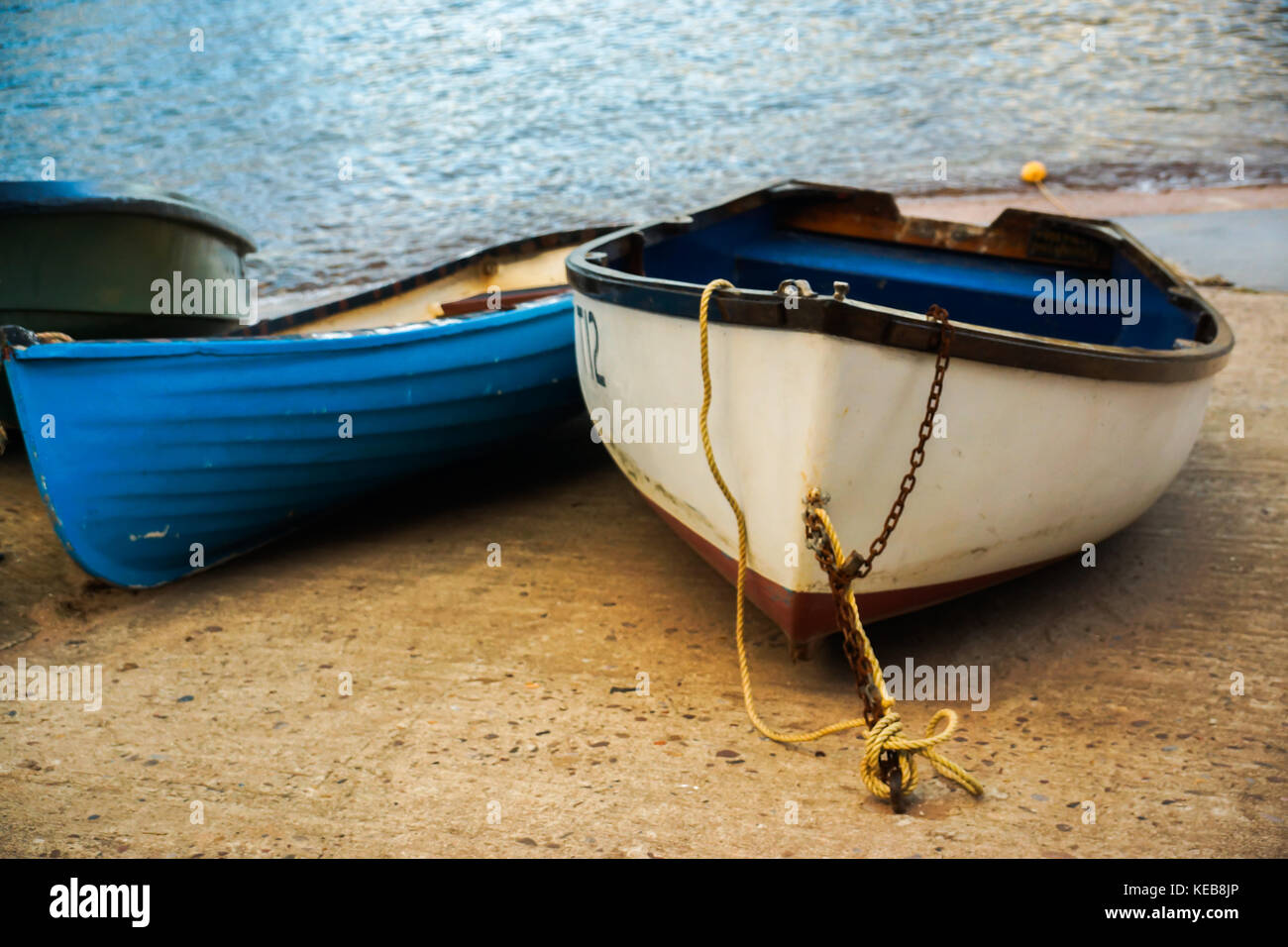 Row boats by the sea in Dawlish, UK - Stock Image