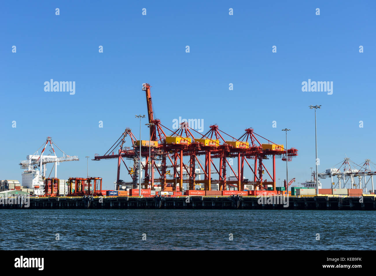 Cranes at West Melbourne container shipping docks on Yarra River, Melbourne, Victoria, Australia - Stock Image