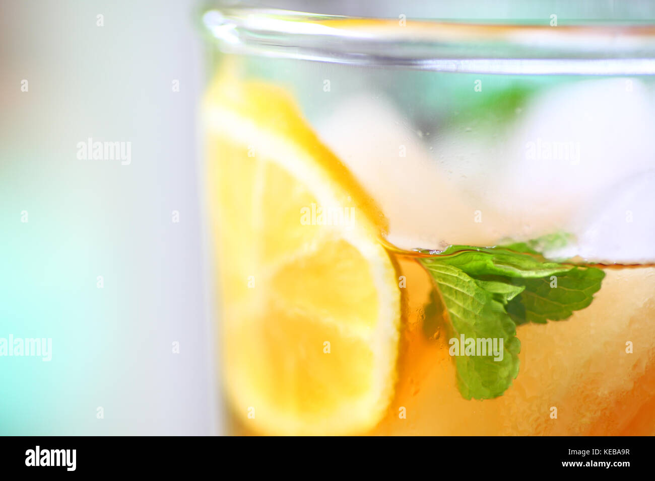 Closeup of iced tea with lemon slice and mint leaves - Stock Image