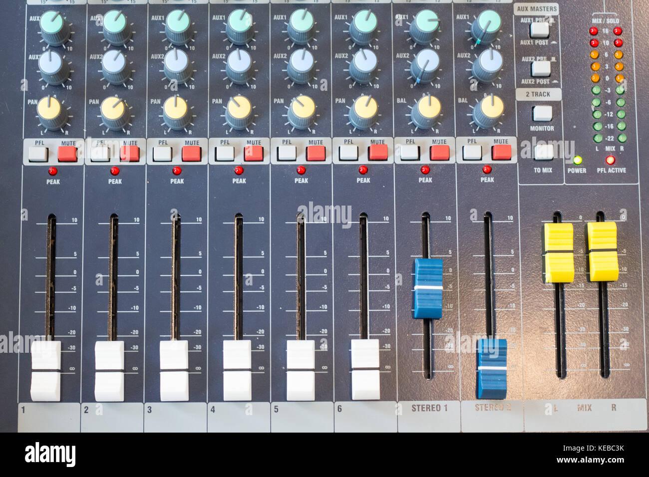 Dj audio mixer controller.Hip hop party dj equipment.Scratch records,mix music tracks.Audio mixer knobs,faders in - Stock Image