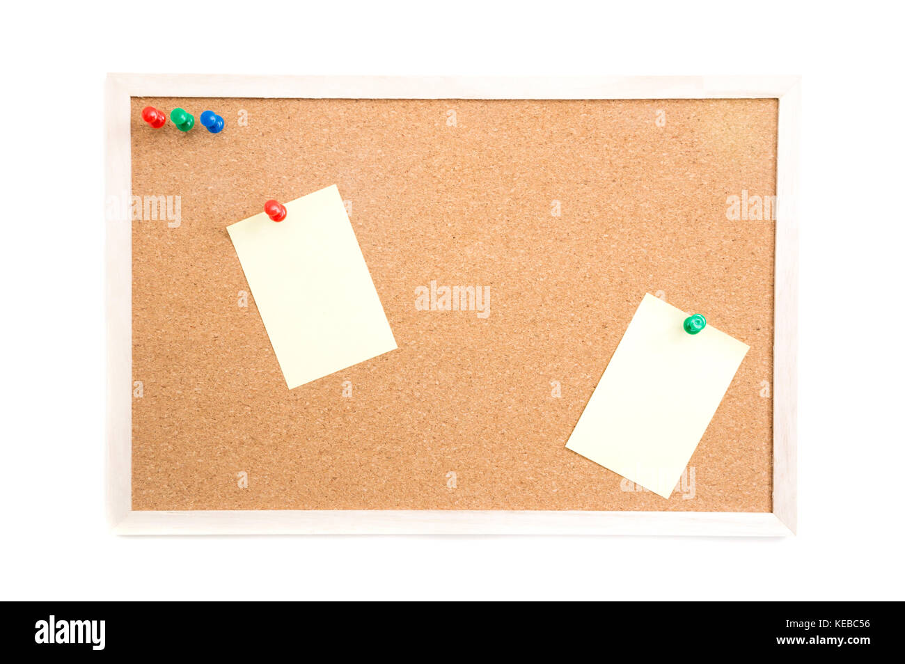 Cork board with post it and push pins and wooden frame on white ...