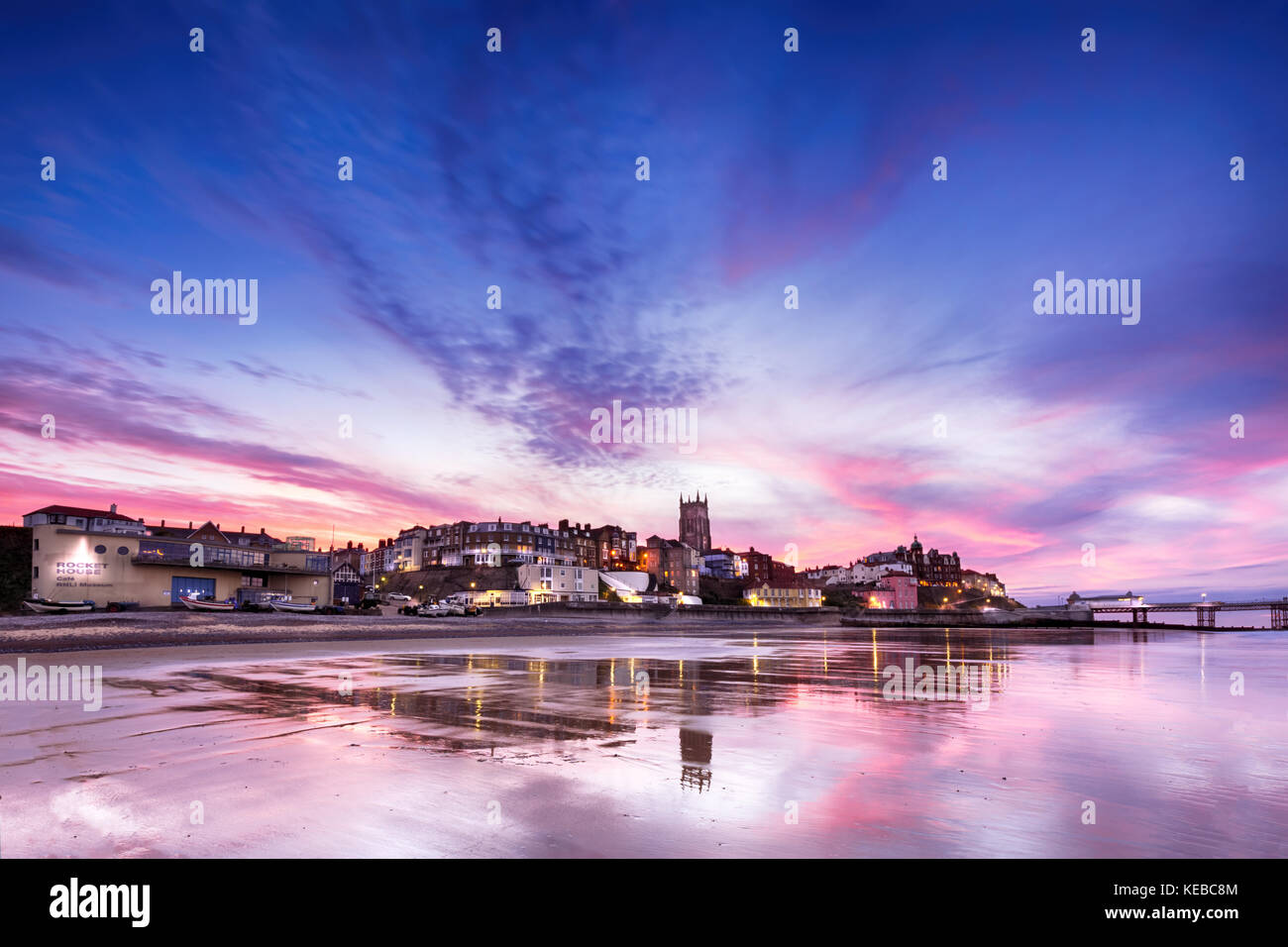 Cromer In Pink - Panoramic view of British seaside town of Comer. Fantastic sunset colours of pinks and purples Stock Photo