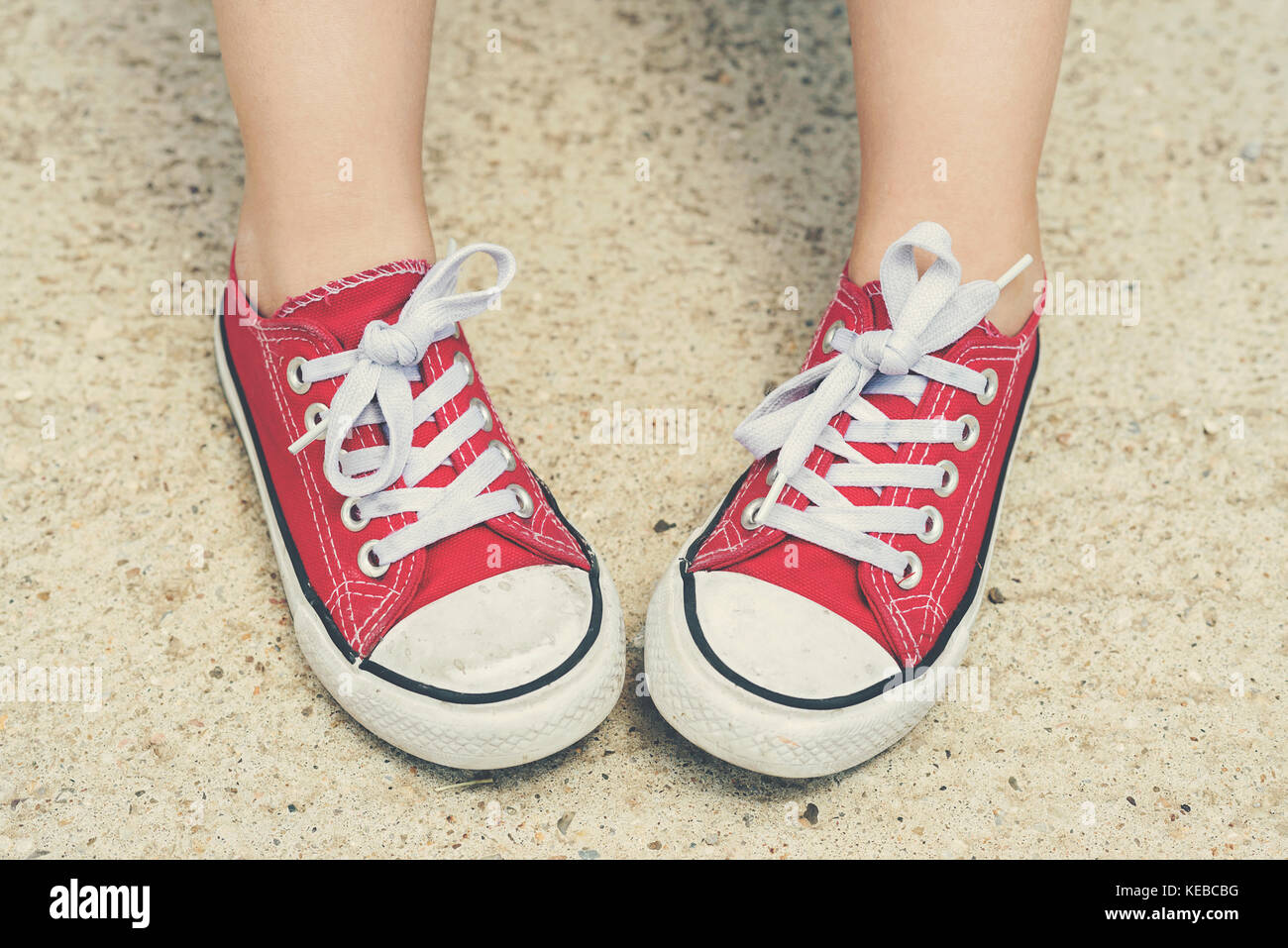 Child with sneakers. Child with red sneakers Child with sneakers. Child with red sneakers - Stock Image