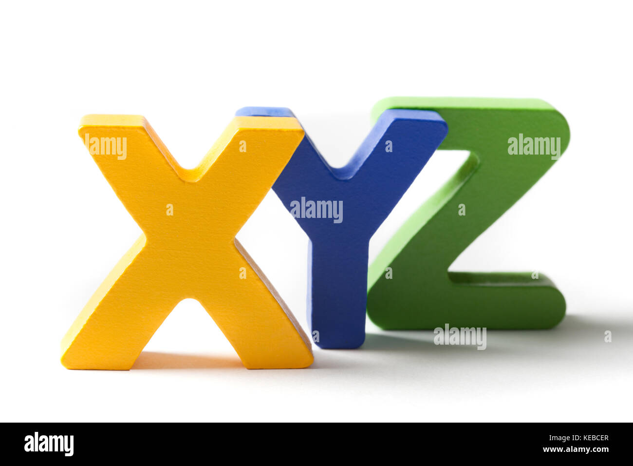 Last three capital letters from the alphabet X,Y and Z, made of wood and isolated on white. - Stock Image