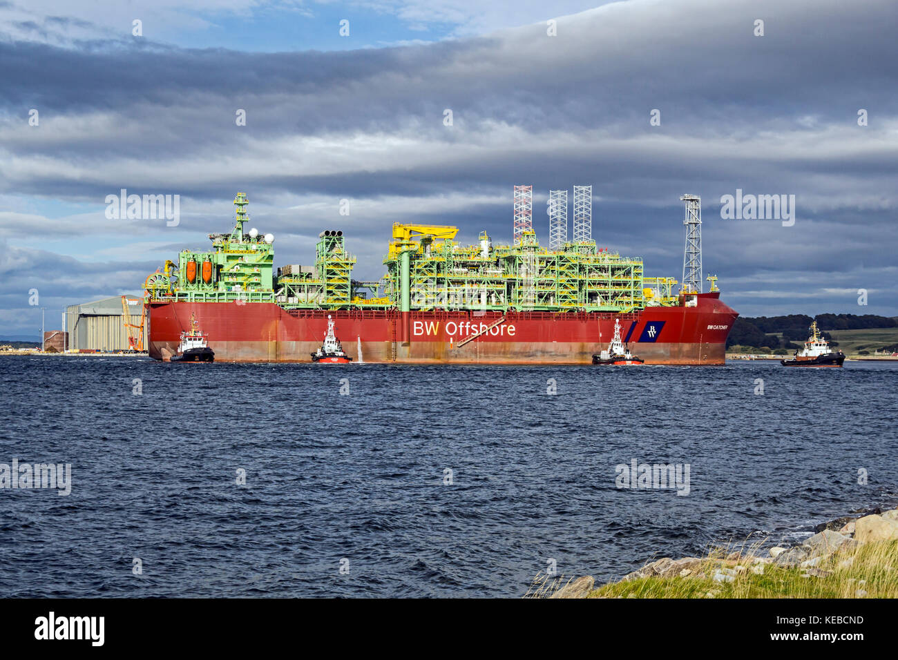 Premier Oil's floating production storage and offloading (FPSO) vessel BW Catcher moving to berth at the Global - Stock Image