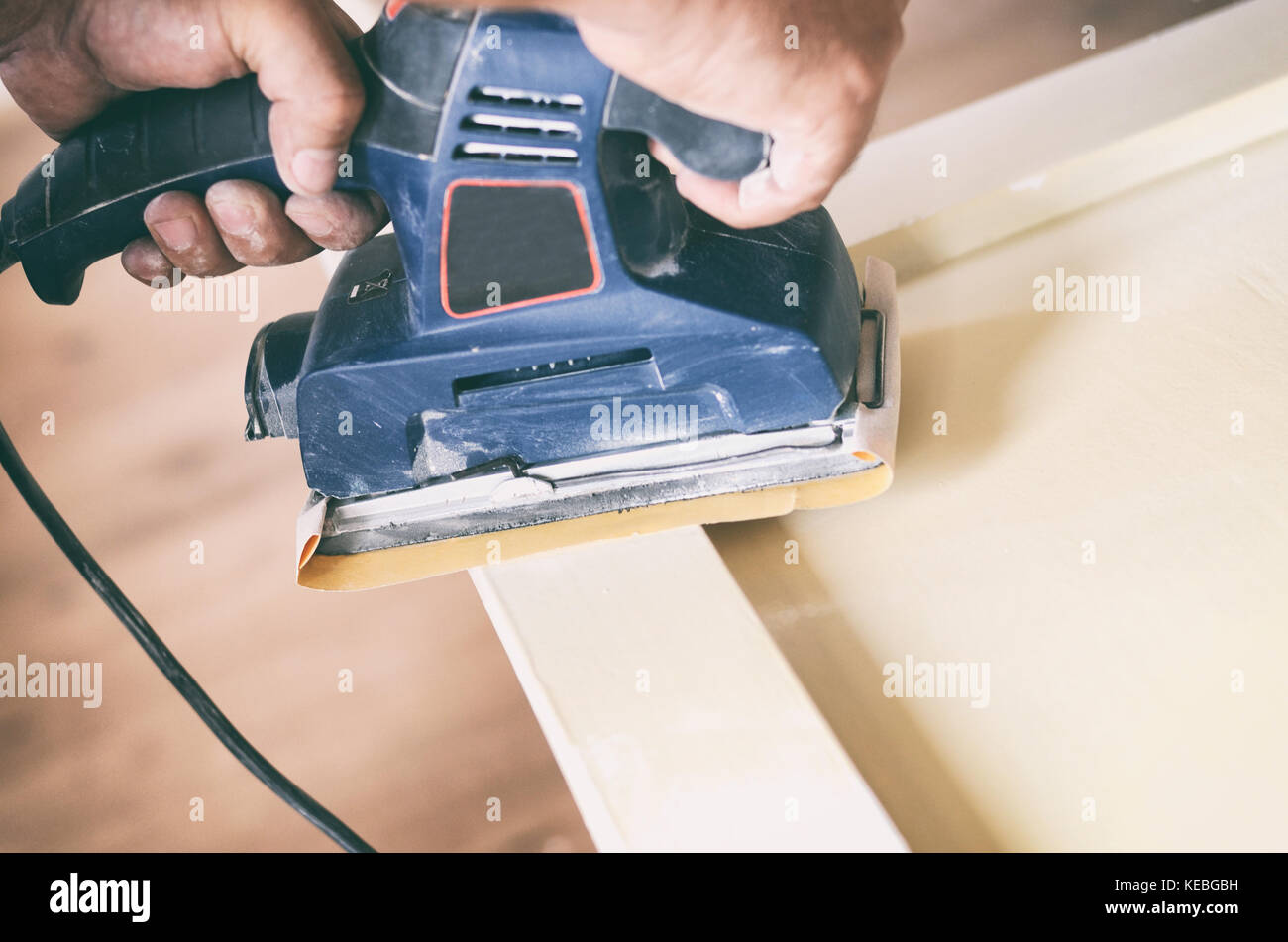 Sanding and preparing old doors with cracked paint for a new lick of paint, Smooth sanding or paint removal concept. - Stock Image