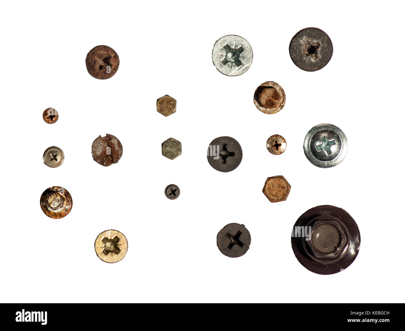 A pile of nuts,bolts, screws and other fasteners on a white background Stock Photo