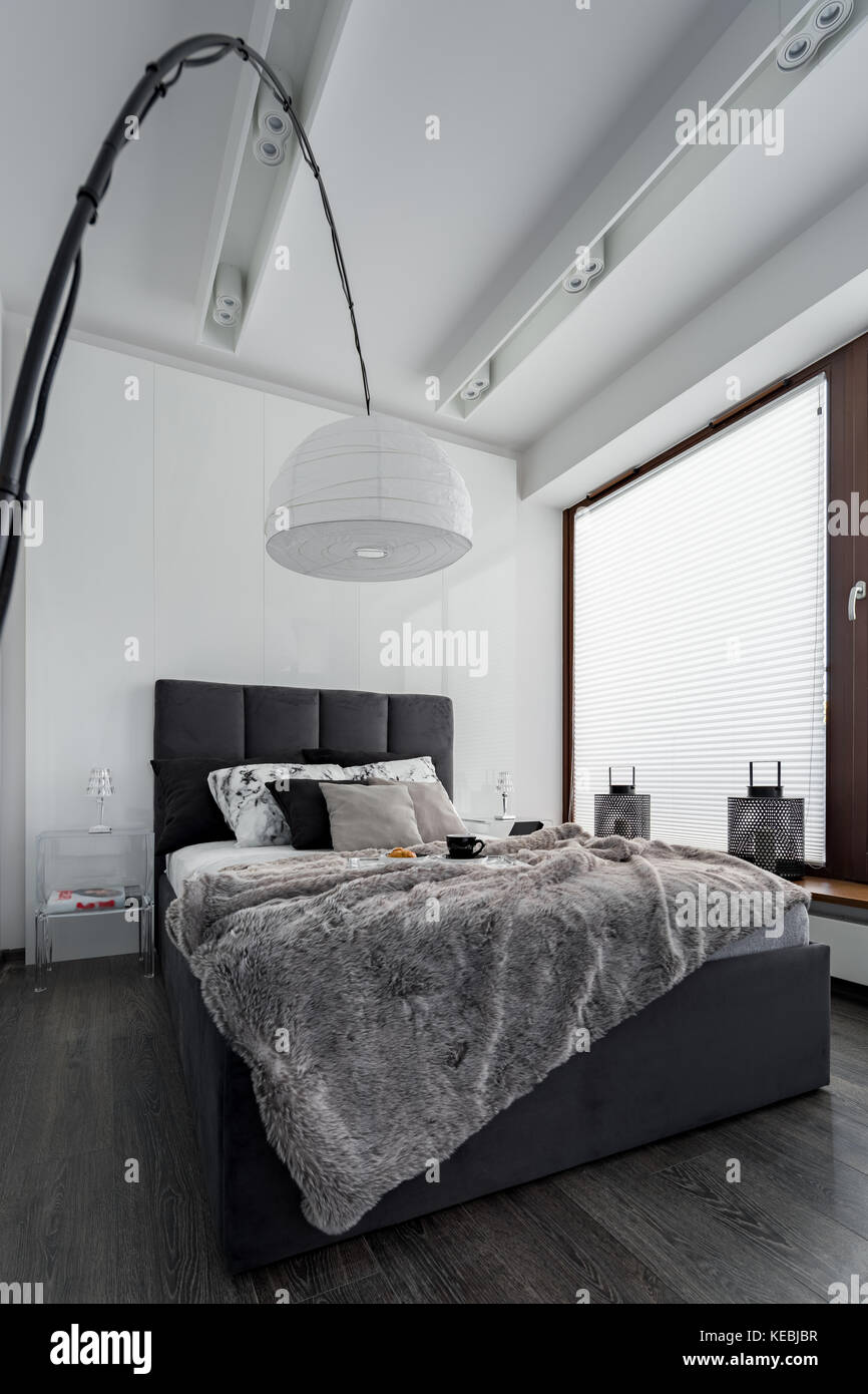 Simple Bedroom With Double Bed And Modern White Lamp Stock Photo Alamy