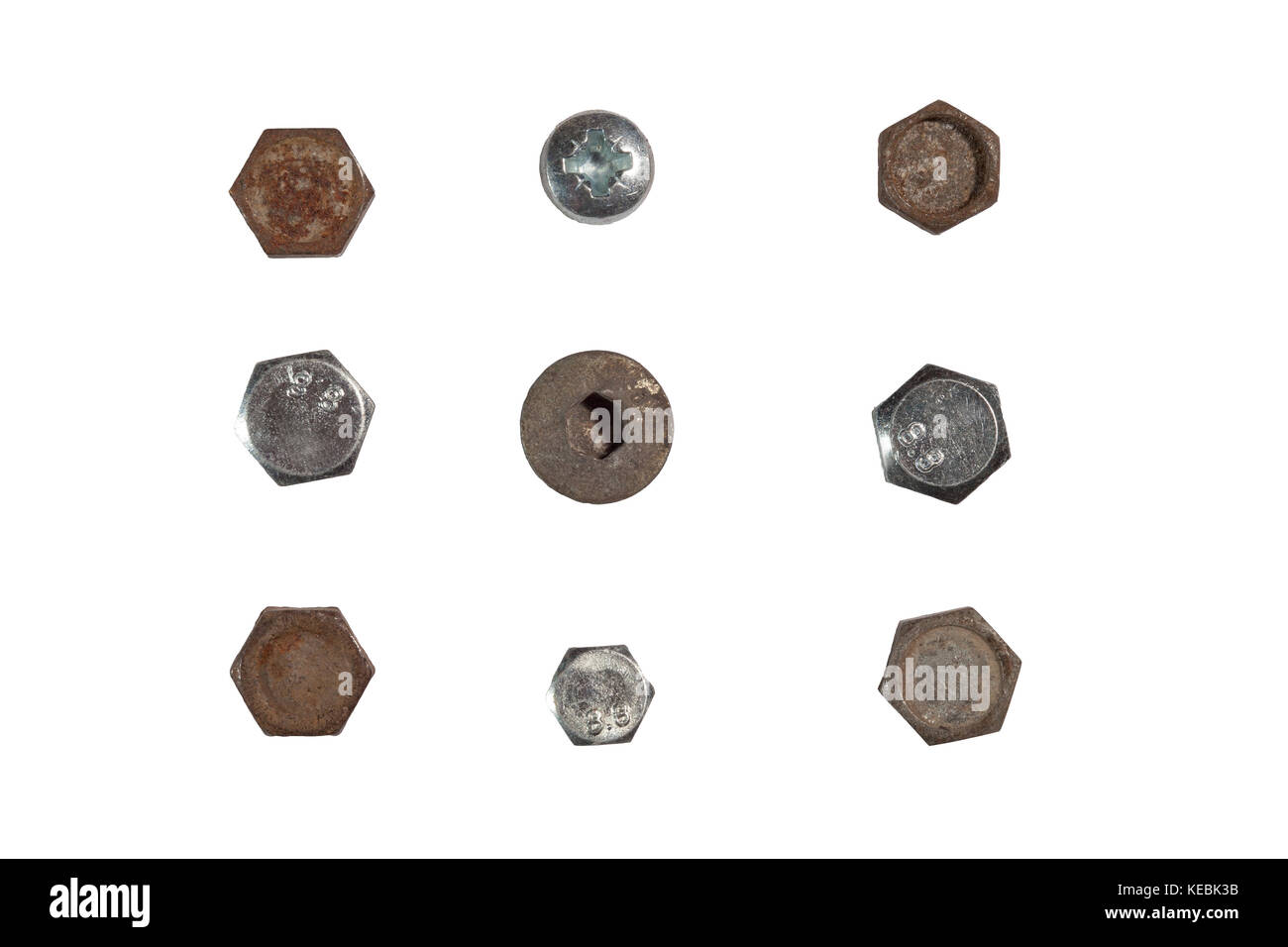 A pile of nuts,bolts, screws and other fasteners on a white background - Stock Image