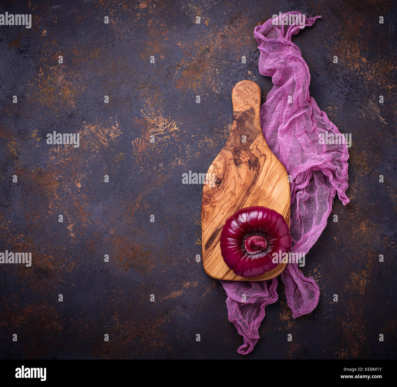 Red onion on old rusty background.  - Stock Image