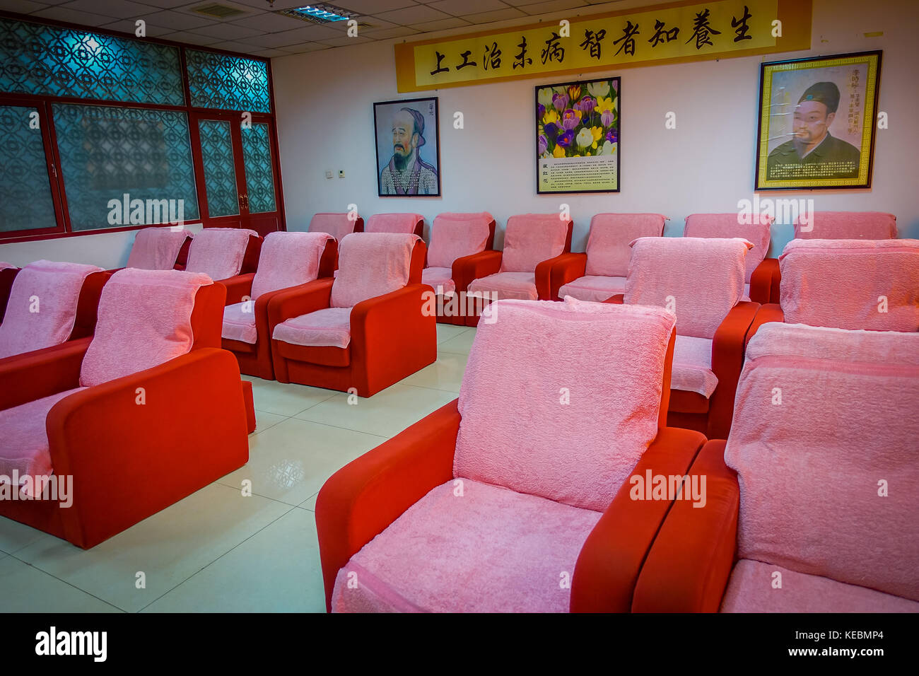 BEIJING, CHINA - 29 JANUARY, 2017: Chinese massage clinic with room full of comfortable chairs used for giving foot - Stock Image