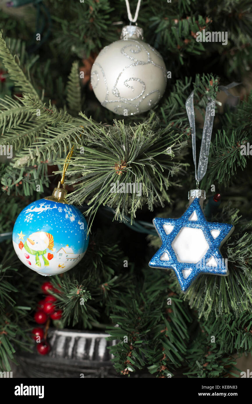 Hanukkah and Christmas decorations on tree - Stock Image