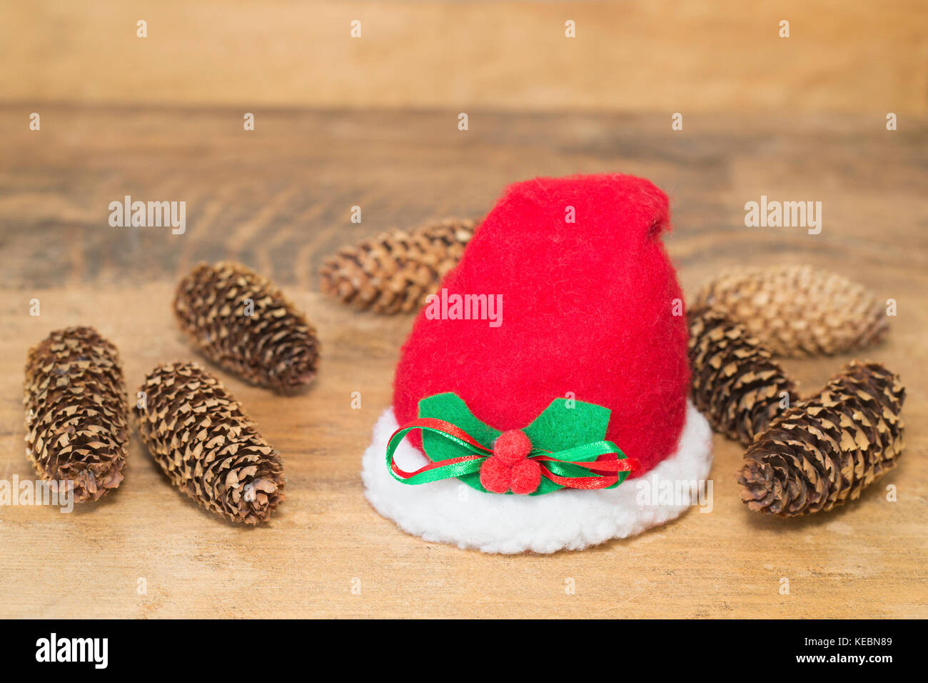 Santa Claus hat and spruce cones - Stock Image