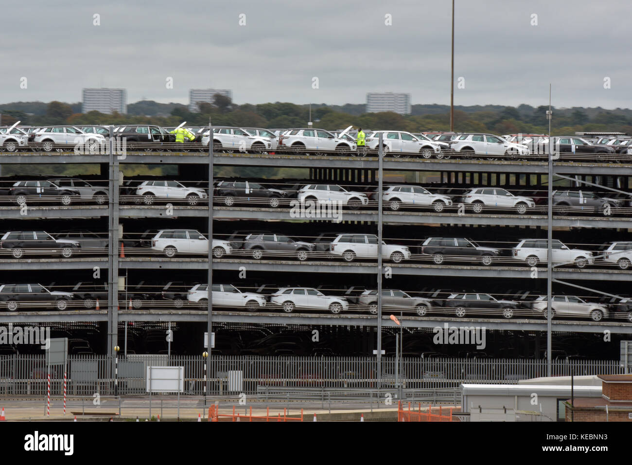 a multi-storey car park in Southampton docks or port full of new cars built or made in the UK ready for export globally Stock Photo
