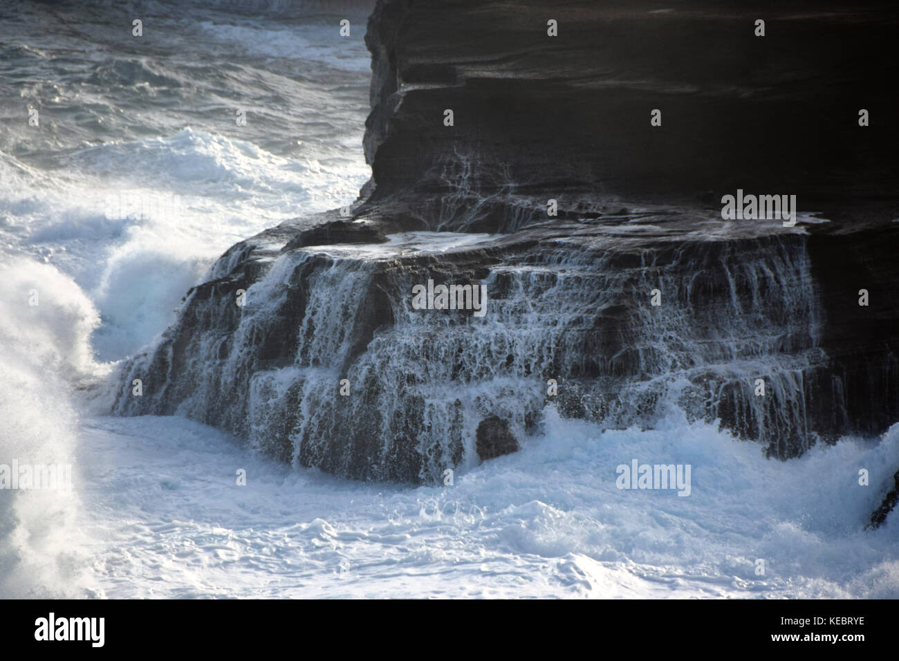 High surf crashes into rocks near the Halona Blowhole in the Southeast corner of Oahu, Hawaii - Stock Image