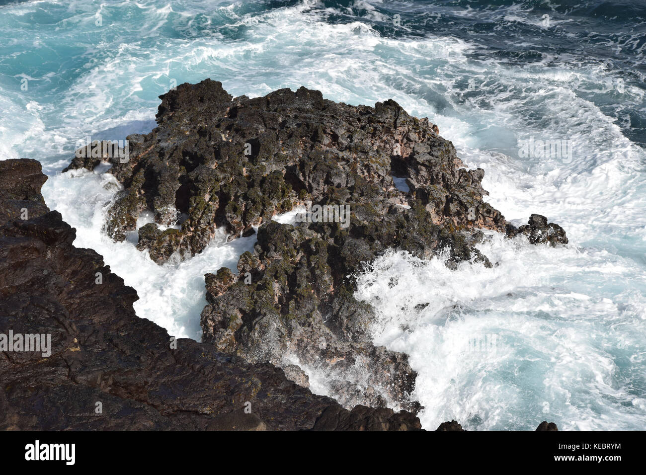 Waves crashing near the Halona Blowhole in the Southeast corner of Oahu, Hawaii - Stock Image