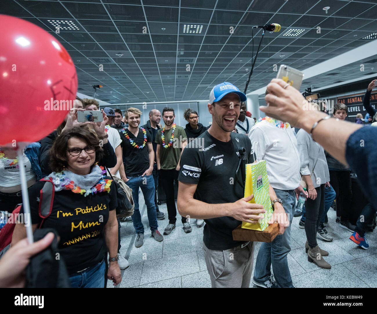 Frankfurt am Main, Germany. 19th Oct, 2017. Ironman World Champion Patrick Lange is received by supporters, among - Stock Image