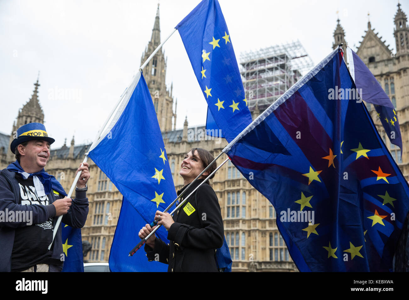 London, UK. 19th Oct, 2017. Anti-Brexit protesters stand with EU flags opposite the Palace of Westminster. Credit: - Stock Image