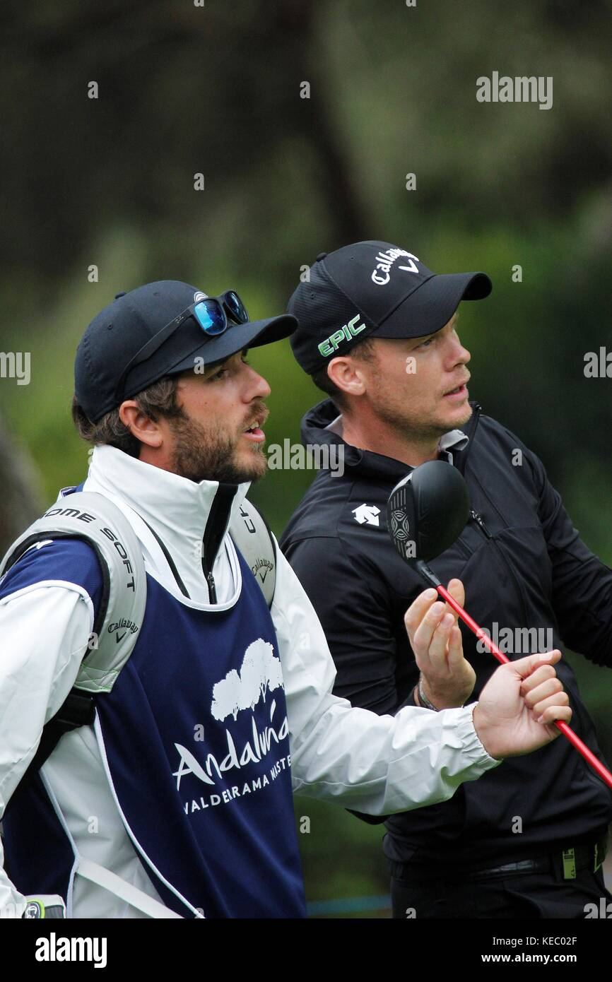 aaba349f03c95 English golf player James Morrison (R) walks during round one of the  Andalucía Valderrama