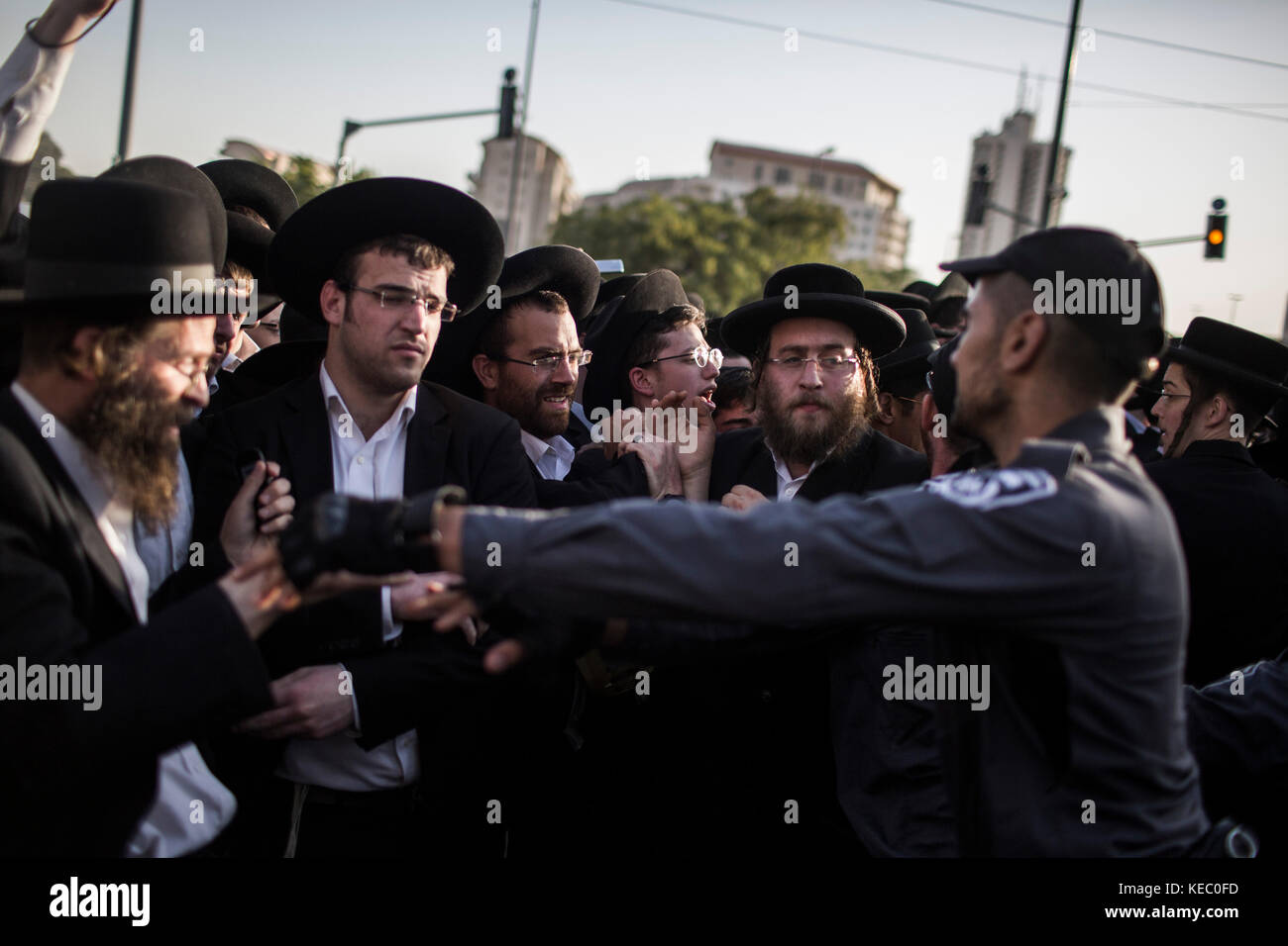 Jerusalem, Israel. 19th Oct, 2017. Ultra Orthodox Jewish men block a road during a protest in Jerusalem, Israel, - Stock Image