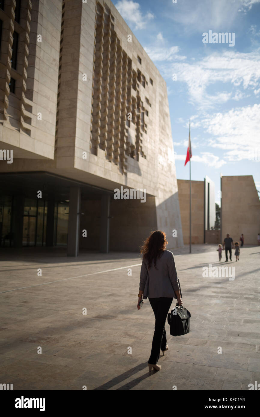 Valletta, Malta. 19th October, 2017. People pass Parliament House (designed by architect Renzo Piano) which houses - Stock Image