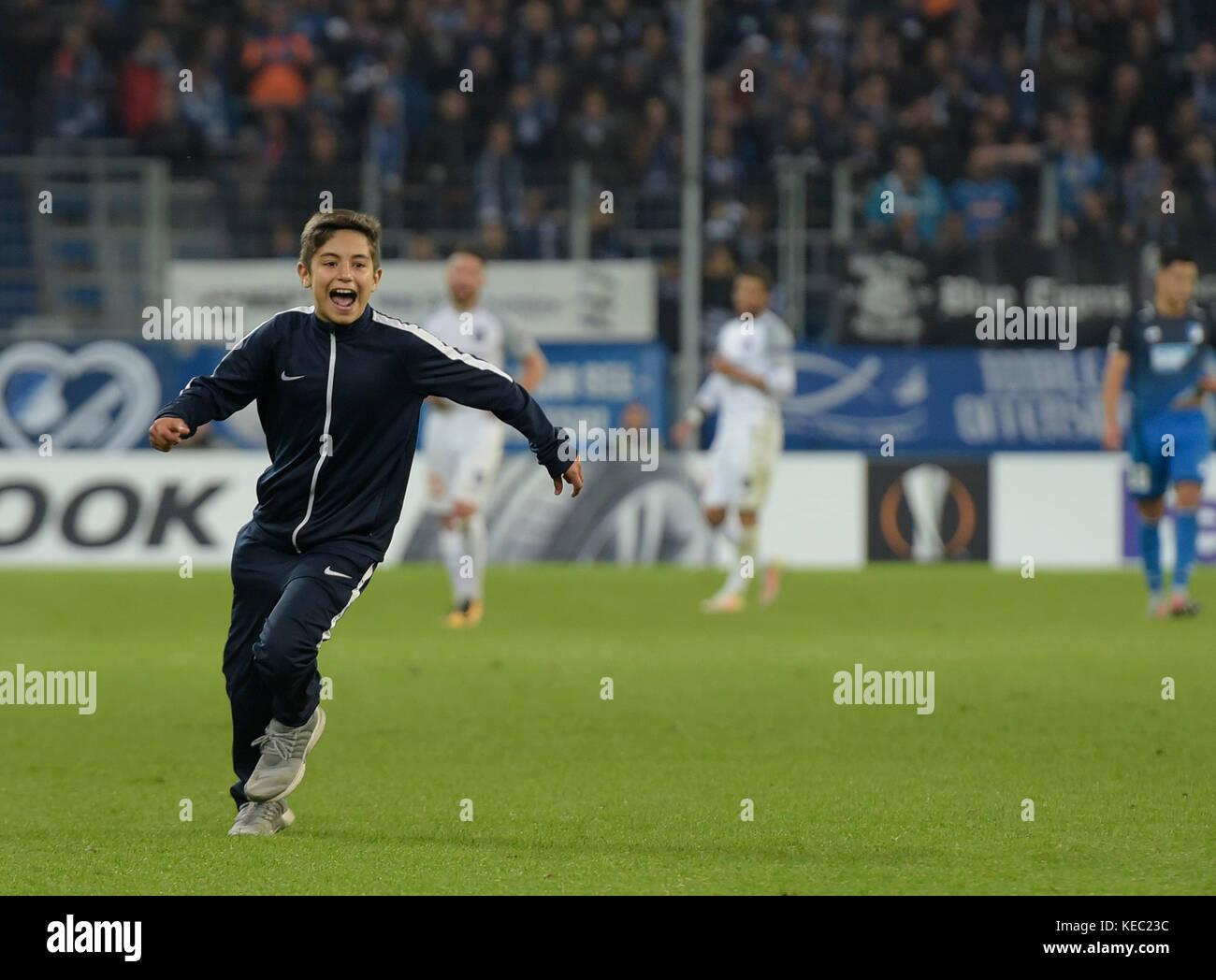 Sinsheim, GER - October 19, Rhein-Neckar-Arena . A kid runs to the field during the the game between TSG Hoffenheim - Stock Image