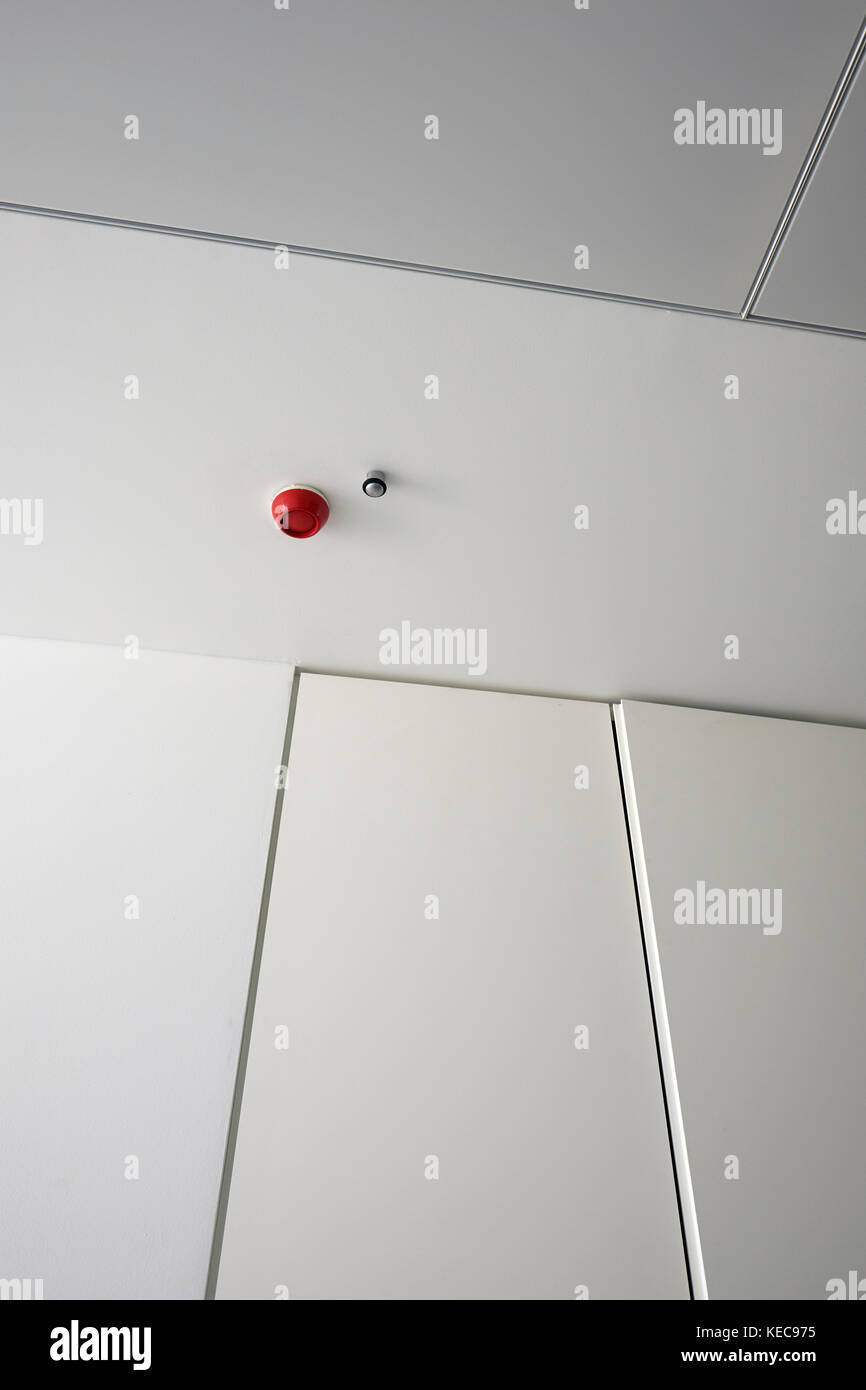 A red fire alarm in a white modern building. Stock Photo