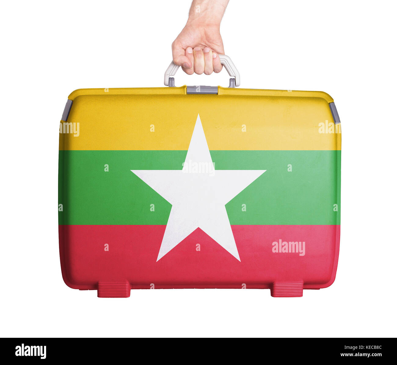 Used plastic suitcase with stains and scratches, printed with flag - Myanmar Stock Photo