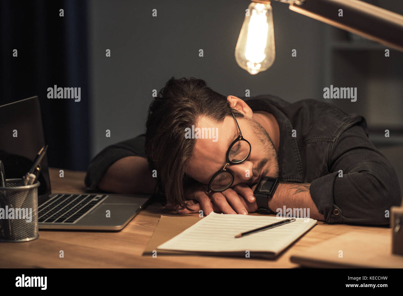 musician sleeping at workplace - Stock Image