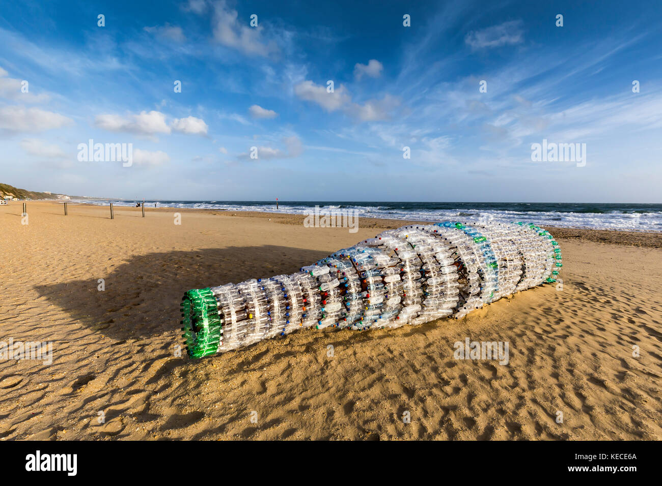 'Message in a Bottle' is an 8-meter long  bottle made from plastic bottles washed up on the beach. It is part of - Stock Image