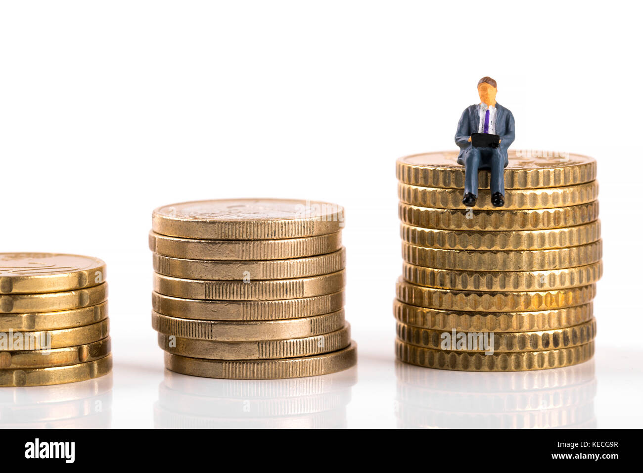 business growth concept - businessman sitting on his profit - Stock Image