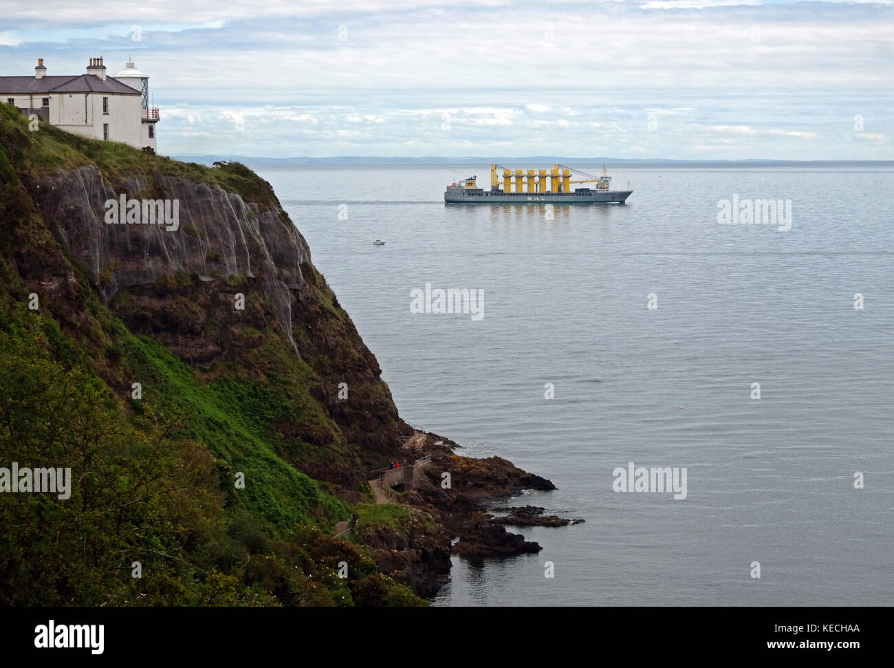 Ship carrying wind turbine transition pieces for fabrication in Belfast. - Stock Image