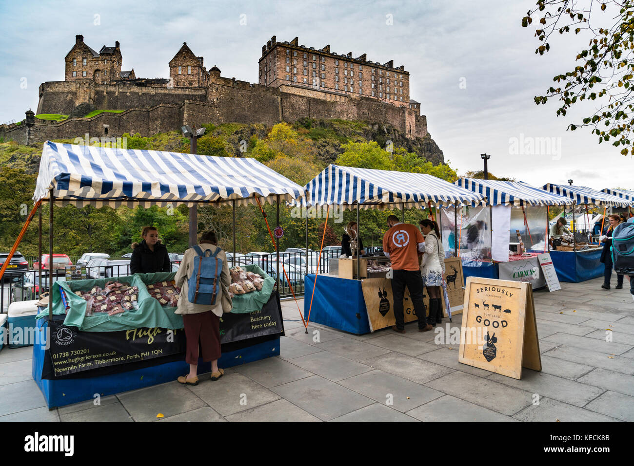 View of Weekend Farmers Market at foot of Edinburgh Castle in Scotland , United Kingdom. - Stock Image