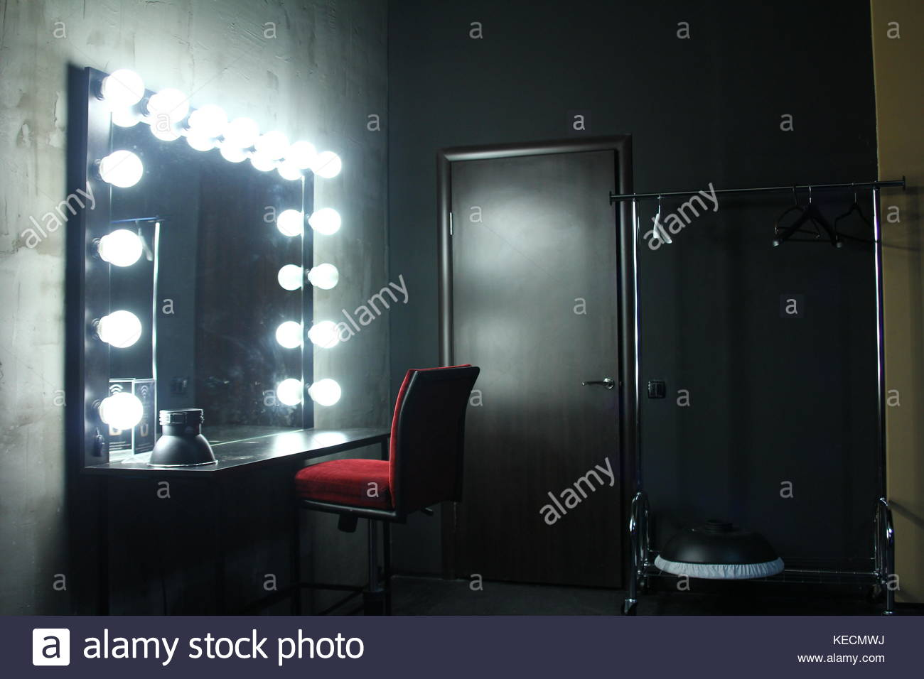 Dressing room with chair, table, mirror and light in the photo studio Stock Photo