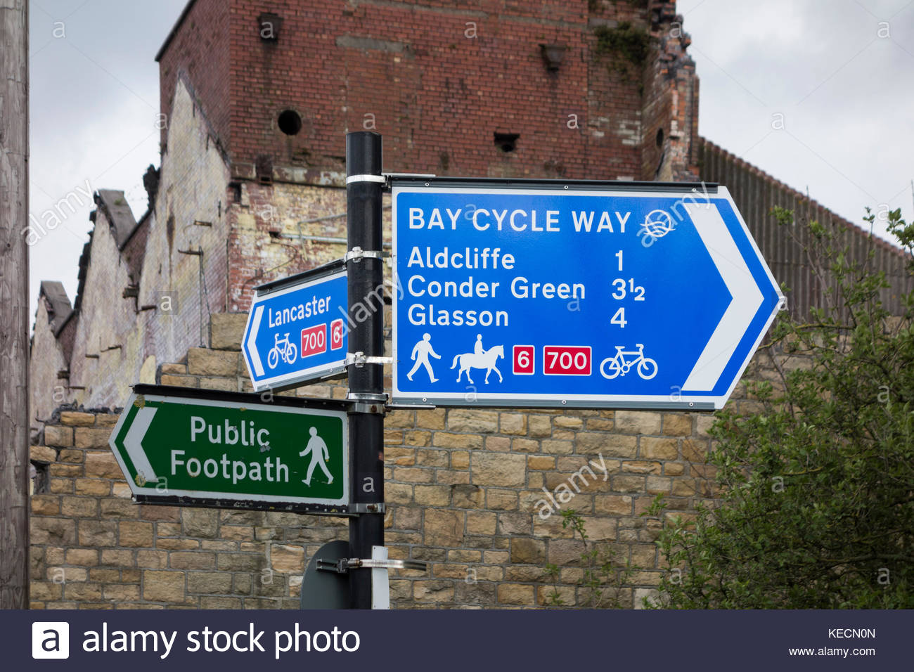 Sign for the Bay Cycleway at the end of St Georges Quay in Lancaster, Lancashire, England, UK close to old industrial - Stock Image