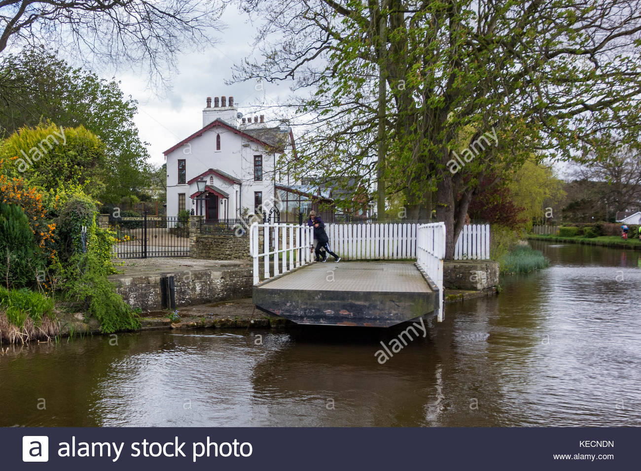 Navigating the swing bridge on the Lancaster Canal at Bolton le Sands, Carnforth, Lancashire, England, UK - Stock Image