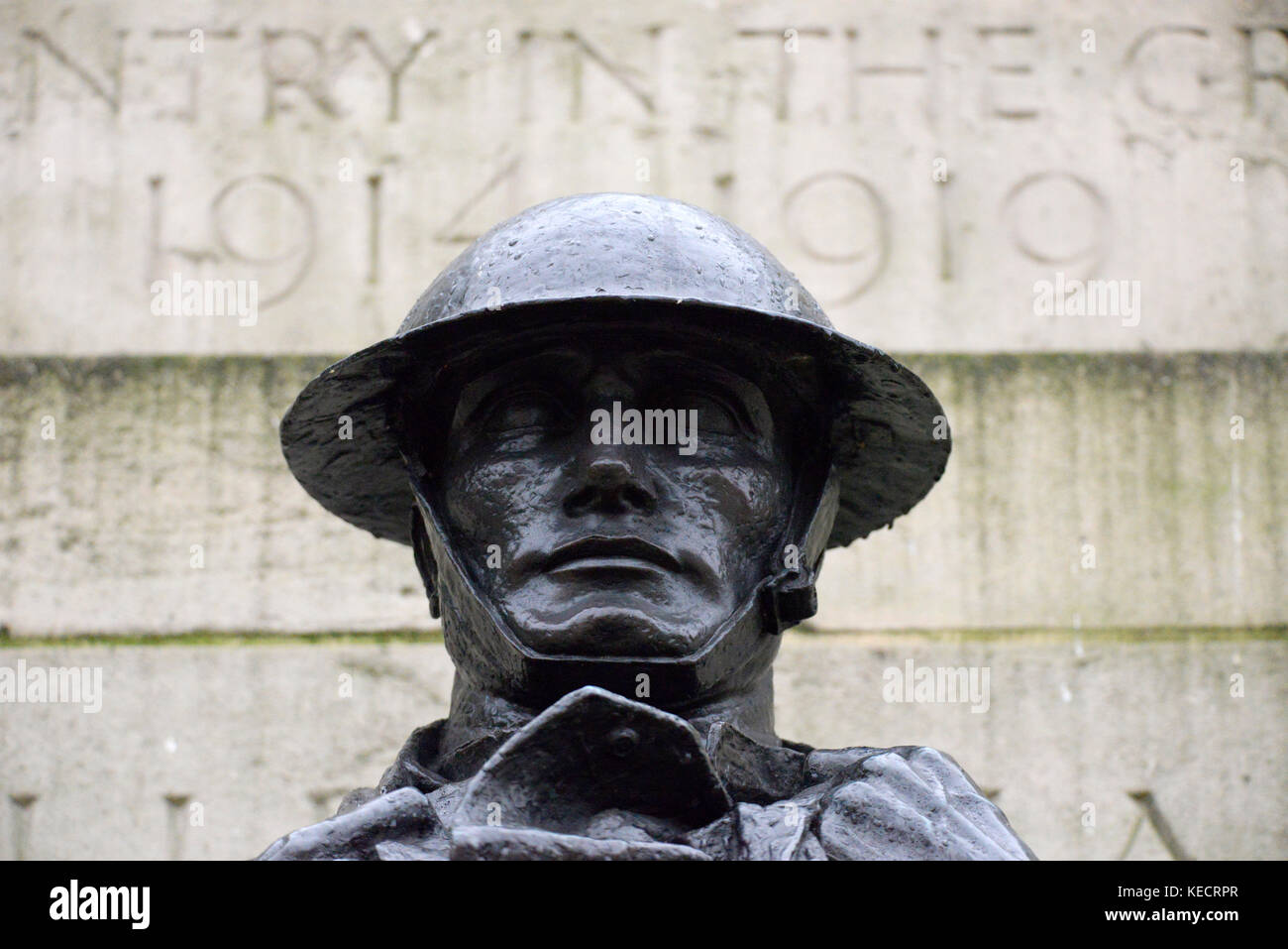 Bronze British Army soldier statue on Royal Artillery Memorial Hyde Park Corner, London. Rain dripping from helmet. - Stock Image