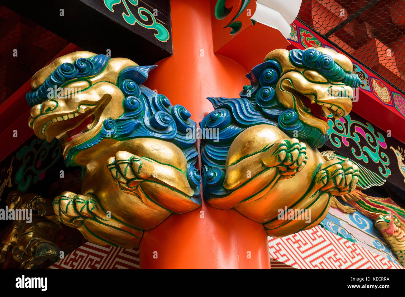 Tokyo, Japan - May 14, 2017:  Colorful wooden guardian lions as a decoration to guard the sacred temple - Stock Image