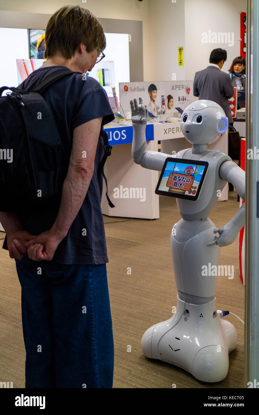 Hiroshima,Japan -  May 23, 2017: Woman communicates with a robot of the Softbank telecommunications store in the - Stock Image