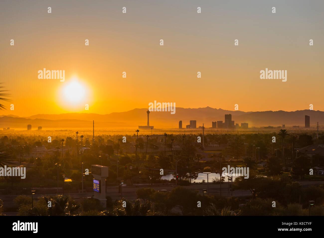 Las Vegas, Nevada, USA - October 10, 2017:  Orange sunrise view of towers on the Las Vegas strip. Stock Photo