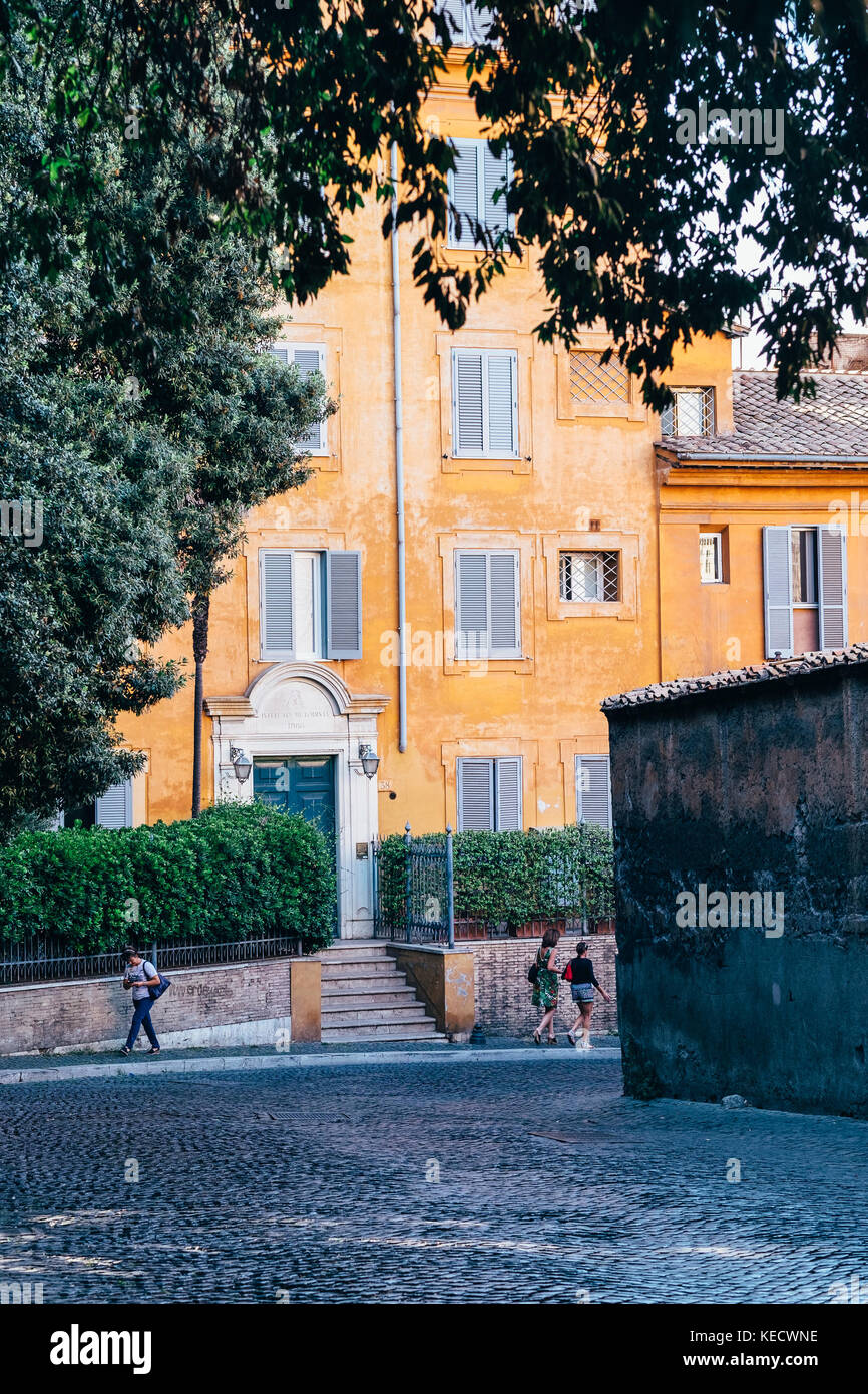 An elegant, tree-lined street in Rome, Italy - Stock Image