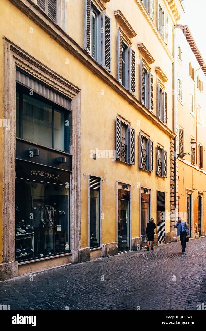 Business people walk to work in the early morning hours in Rome, Italy, near the Pantheon - Stock Image