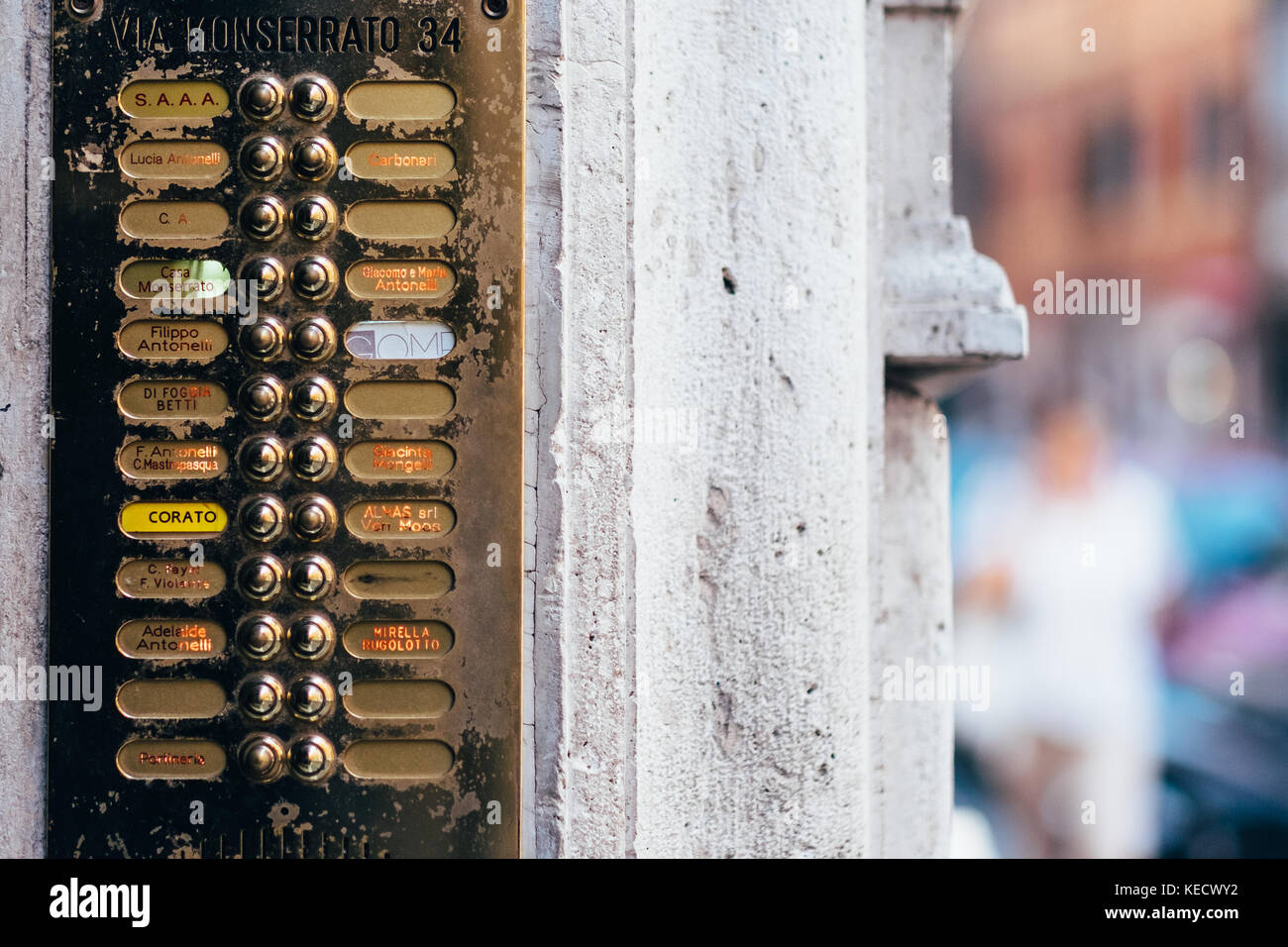Elegant old doorbells and mismached address and name labels on a building in Rome, Italy - Stock Image