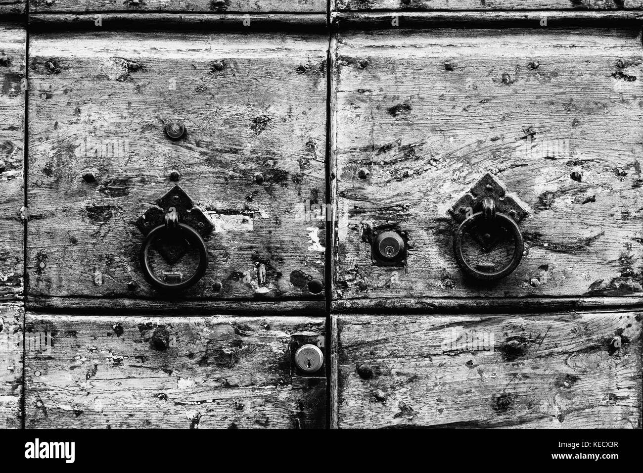 Detail from a worn wooden door in Rome, Italy - Stock Image