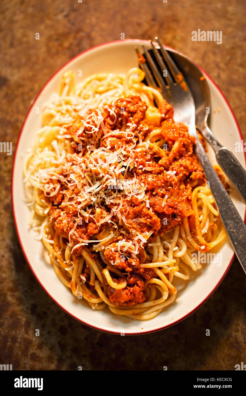 Spaghetti Bolognese with minced beef, tomato sauce, grated parmesan - Stock Image