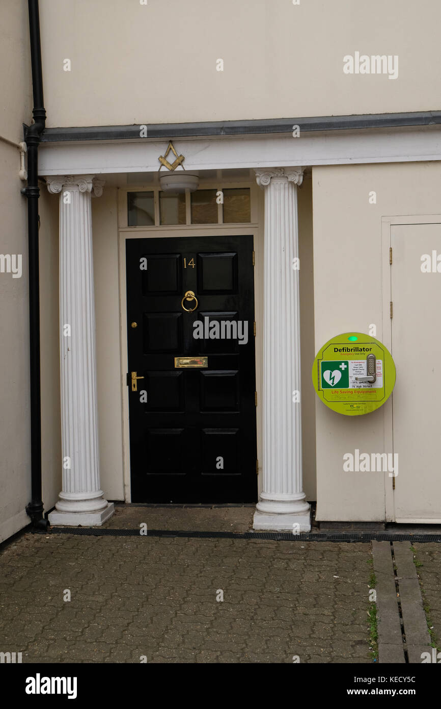 June 2017- Life saving defibrillators mounted on the walls of a busy high street in Thame Oxfordshire, - Stock Image