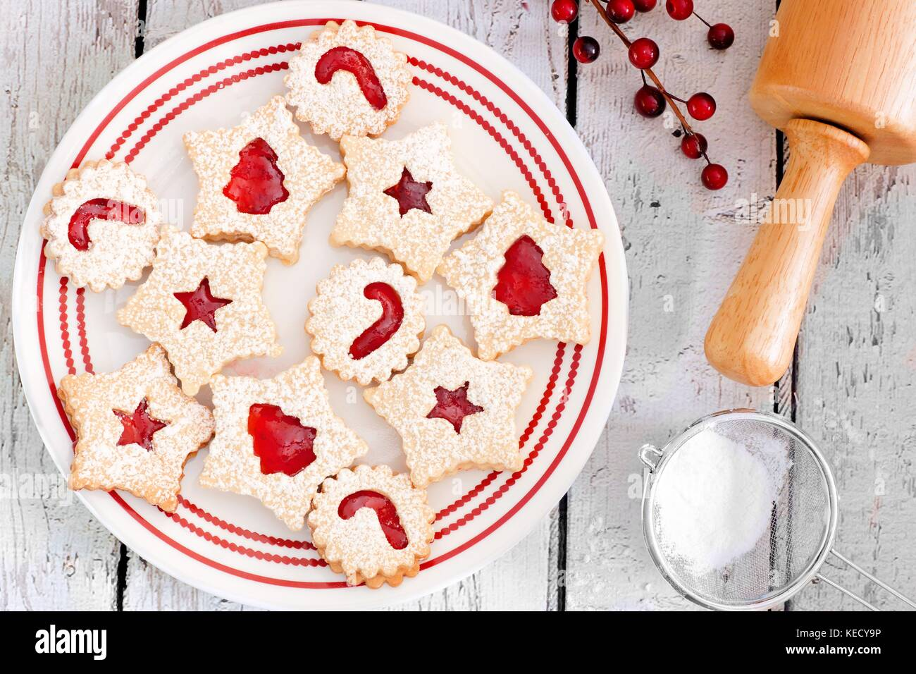 Christmas Jam Filled Cookies Overhead Scene On A White Wood Stock