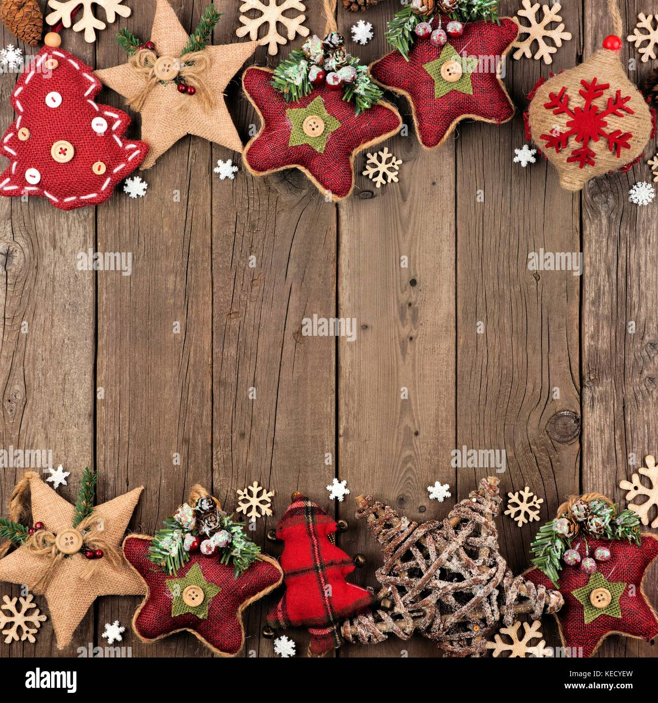 Rustic Christmas Double Border With Burlap And Cloth Ornaments Over An Aged Wood Background