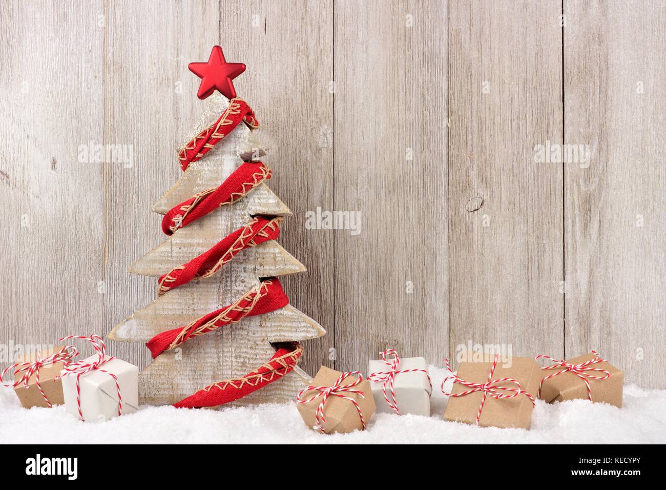 Shabby Chic Wooden Christmas Tree With Rustic Red Garland And Gifts Stock Photo Alamy